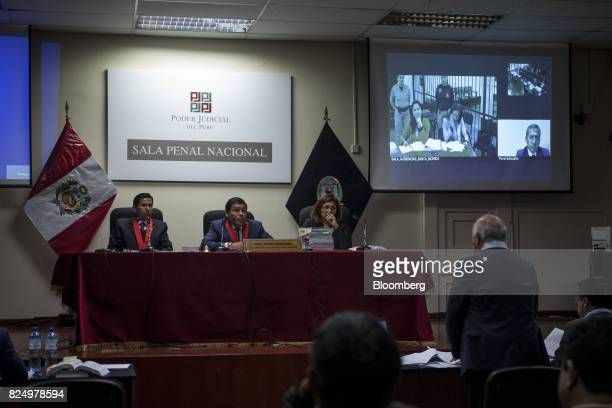 Wilfredo Pedraza attorney for former Peruvian President Ollanta Humala's wife Nadine Heredia left speaks to members of the court as Humala and...