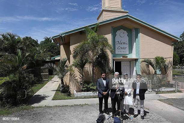 Wilfredo Ruiz from the Council on AmericanIslamic Relations speaks to the media with other officials in front of the Islamic Center of Fort Pierce as...