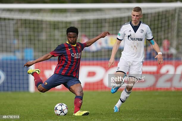 Wilfrid Kaptoum of FC Barcelona kicks the ball under pressure from Felix Platte of FC Schalke 04 during the UEFA Youth League Semi Final match...