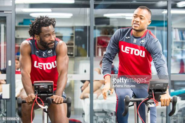 Wilfried Bony and Jordan Ayew exercise in the gym during the Swansea City training session at The Fairwood training Ground on November 16 2017 in...