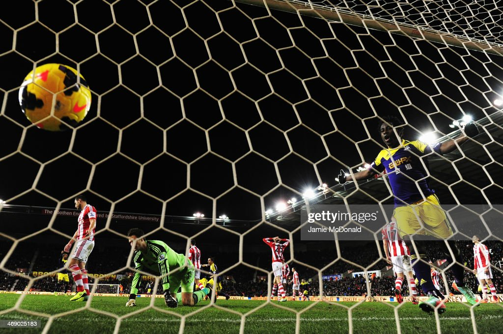 Wilfried Bony celebrates as Chico Flores of Swansea City scores past Asmir Begovic the Stoke City goalkeeper during the Barclays Premier League match...