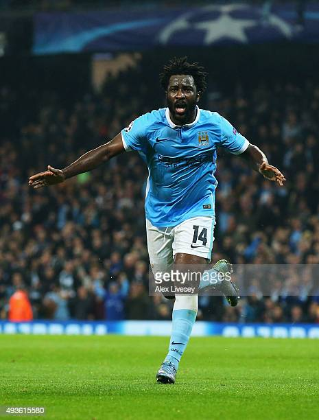 Wilfried Bony of Manchester City celebrates his teams opening goal an own goal by Adil Rami of Sevilla during the UEFA Champions League Group D match...