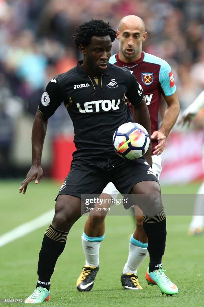 Wilfried Bony of Swansea City avoids Pablo Zabaleta of West Ham United during the Premier League match between West Ham United and Swansea City at London Stadium on September 30, 2017 in London, England.