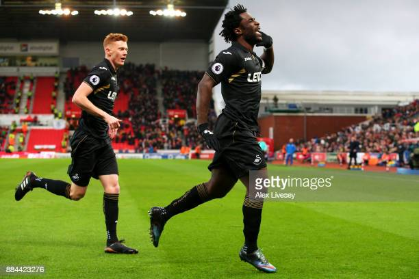 Wilfried Bony of Swansea City celebrates after scoring his sides first goal during the Premier League match between Stoke City and Swansea City at...
