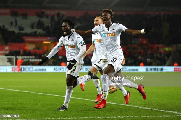 Wilfried Bony of Swansea City celebrates after scoring his sides first goal with Tammy Abraham of Swansea City and Mike van der Hoorn of Swansea City...