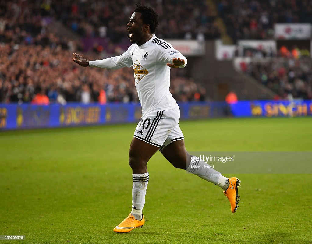 Wilfried Bony of Swansea City celebrates as he scores their first goal during the Barclays Premier League match between Swansea City and Crystal...