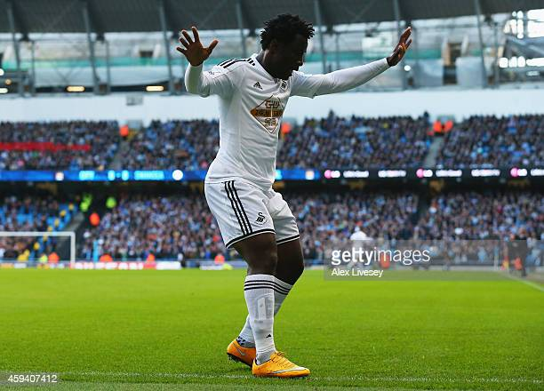 Wilfried Bony of Swansea City celebrates his opening goal during the Barclays Premier League match between Manchester City and Swansea City at Etihad...