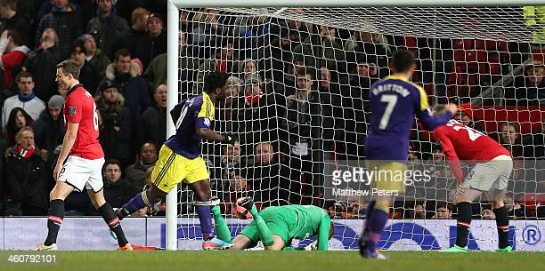 Wilfried Bony of Swansea City celebrates scoring their second goal during the FA Cup Third Round match between Manchester United and Swansea City at...