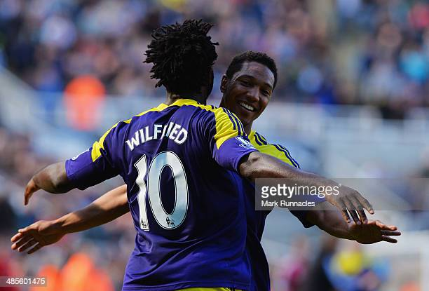 Wilfried Bony of Swansea City celebrates with Jonathan de Guzman of Swansea City as he scores their first goal during the Barclays Premier League...