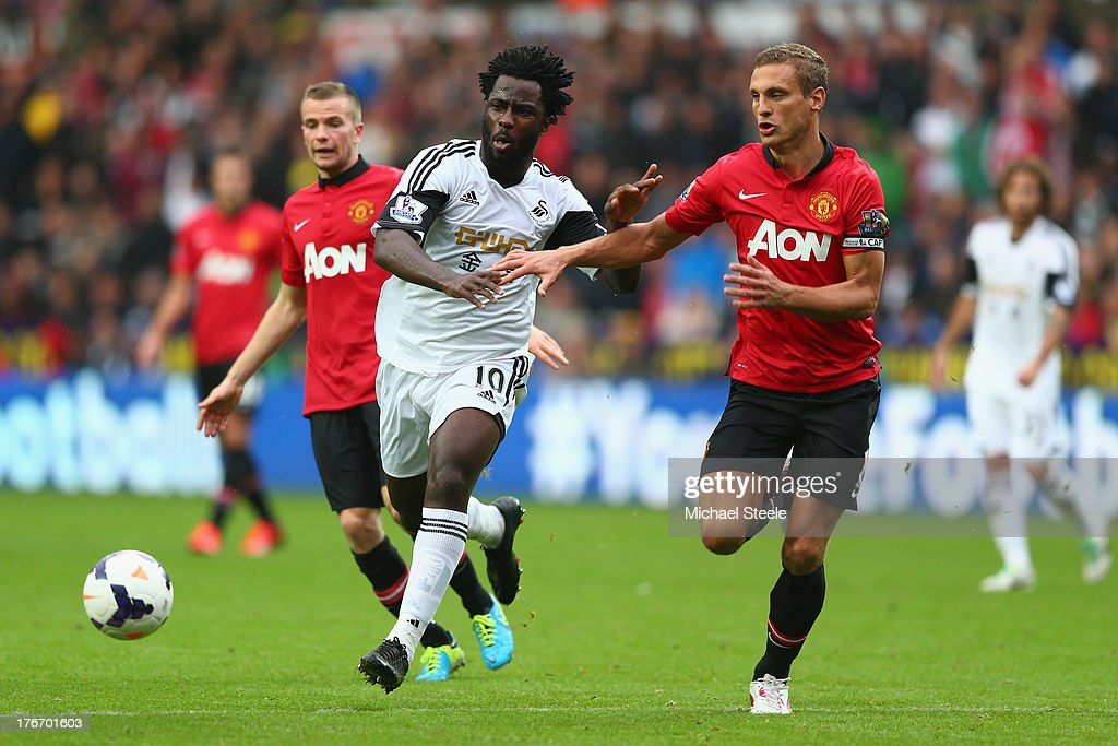 <a gi-track='captionPersonalityLinkClicked' href=/galleries/search?phrase=Wilfried+Bony&family=editorial&specificpeople=4231248 ng-click='$event.stopPropagation()'>Wilfried Bony</a> (L) of Swansea City is tracked by Nemanja Vidic (R) of Manchester United during the Barclays Premier League match between Swansea City and Manchester United at the Liberty Stadium on August 17, 2013 in Swansea, Wales.