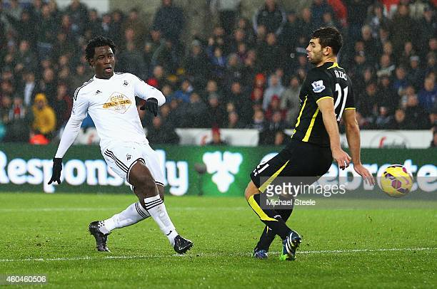 Wilfried Bony of Swansea City scores his goal under a challenge from Federico Fazio of Tottenham Hotspur during the Barclays Premier League match...