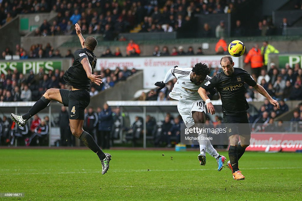 <a gi-track='captionPersonalityLinkClicked' href=/galleries/search?phrase=Wilfried+Bony&family=editorial&specificpeople=4231248 ng-click='$event.stopPropagation()'>Wilfried Bony</a> (C) of Swansea City scores his sides opening goal as Pablo Zabaleta (R) of Manchester City fails to challenge during the Barclays Premier League match between Swansea City and Manchester City at the Liberty Stadium on January 1, 2014 in Swansea, Wales.