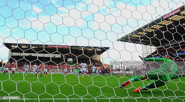 Wilfried Bony of Swansea City scores the first goal from the penalty spot past Asmir Begovic of Stoke City during the Barclays Premier League match...