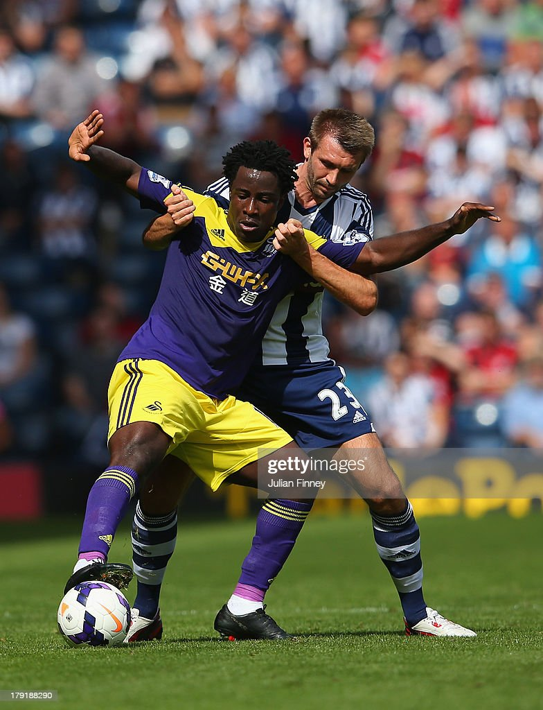 Wilfried Bony of Swansea holds off Gareth McAuley of West Brom during the Barclays Premier League match between West Bromwich Albion and Swansea City at The Hawthorns on September 01, 2013 in West Bromwich, England.