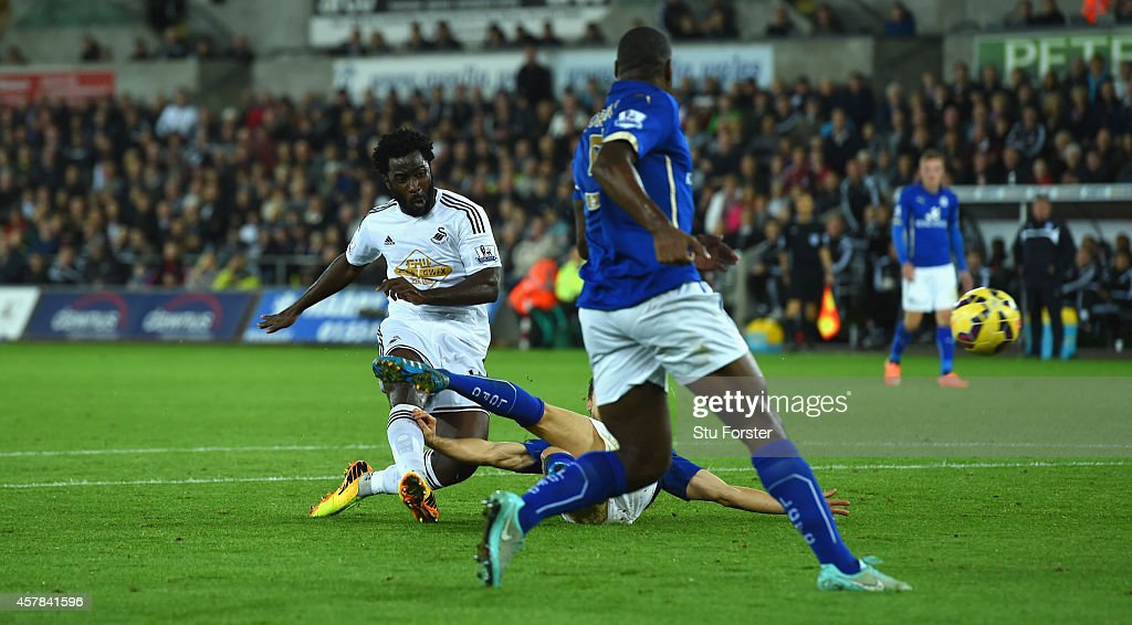 Wilfried Bony of Swansea shoots to score the opening goal during the Barclays Premier League match between Swansea City and Leicester City at Liberty...