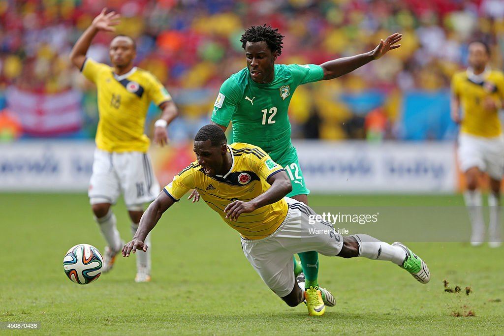 <a gi-track='captionPersonalityLinkClicked' href=/galleries/search?phrase=Wilfried+Bony&family=editorial&specificpeople=4231248 ng-click='$event.stopPropagation()'>Wilfried Bony</a> of the Ivory Coast and <a gi-track='captionPersonalityLinkClicked' href=/galleries/search?phrase=Cristian+Zapata&family=editorial&specificpeople=854055 ng-click='$event.stopPropagation()'>Cristian Zapata</a> of Colombia compete for the ball during the 2014 FIFA World Cup Brazil Group C match between Colombia and Cote D'Ivoire at Estadio Nacional on June 19, 2014 in Brasilia, Brazil.