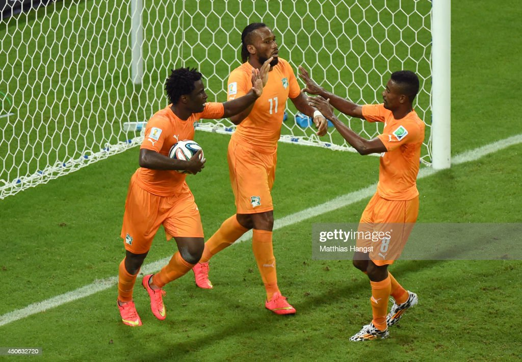 <a gi-track='captionPersonalityLinkClicked' href=/galleries/search?phrase=Wilfried+Bony&family=editorial&specificpeople=4231248 ng-click='$event.stopPropagation()'>Wilfried Bony</a> of the Ivory Coast (L) celebrates scoring his team's first goal with <a gi-track='captionPersonalityLinkClicked' href=/galleries/search?phrase=Didier+Drogba&family=editorial&specificpeople=179398 ng-click='$event.stopPropagation()'>Didier Drogba</a> (C) and <a gi-track='captionPersonalityLinkClicked' href=/galleries/search?phrase=Salomon+Kalou&family=editorial&specificpeople=453312 ng-click='$event.stopPropagation()'>Salomon Kalou</a> during the 2014 FIFA World Cup Brazil Group C match between the Ivory Coast and Japan at Arena Pernambuco on June 14, 2014 in Recife, Brazil.