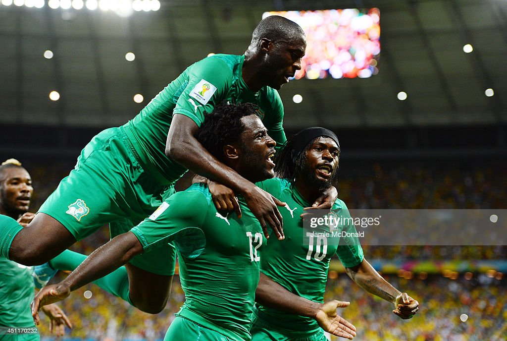 Wilfried Bony of the Ivory Coast celebrates scoring his team's first goal with Yaya Toure and Gervinho during the 2014 FIFA World Cup Brazil Group C...