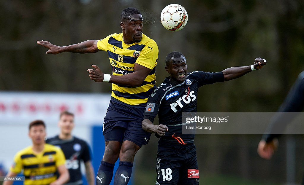 Wilfried Domoraud of Hobro IK and Adama Guira of Sonderjyske compete for the ball during the Danish Alka Superliga match between Hobro IK and Sonderjyske at DS Arena on April 30, 2016 in Hobro, Denmark.