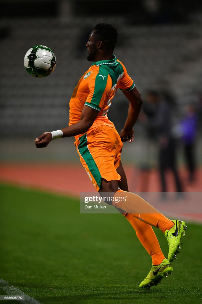 All National Teams PES 2013 - Page 4 Wilfried-kanon-of-the-ivory-coast-leaps-to-control-the-ball-during-picture-id658696270