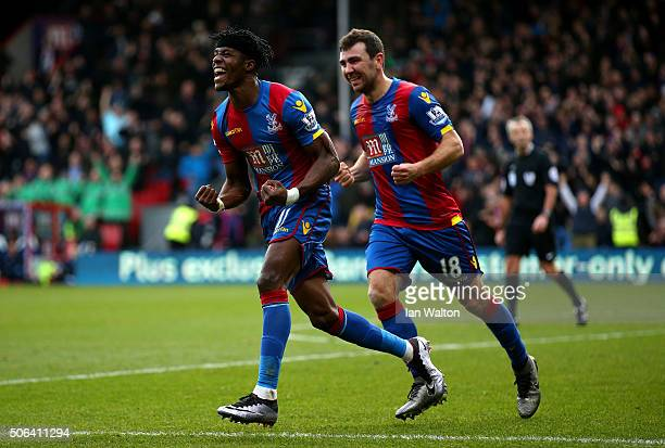 Wilfried Zaha and James McArthur of Crystal Palace celebrate their first goal own goal by Jan Vertonghen of Tottenham Hotspur during the Barclays...