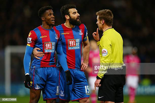 Wilfried Zaha and Mile Jedinak of Crystal Palace protest to referee Mike Jones during the Barclays Premier League match between Crystal Palace and...