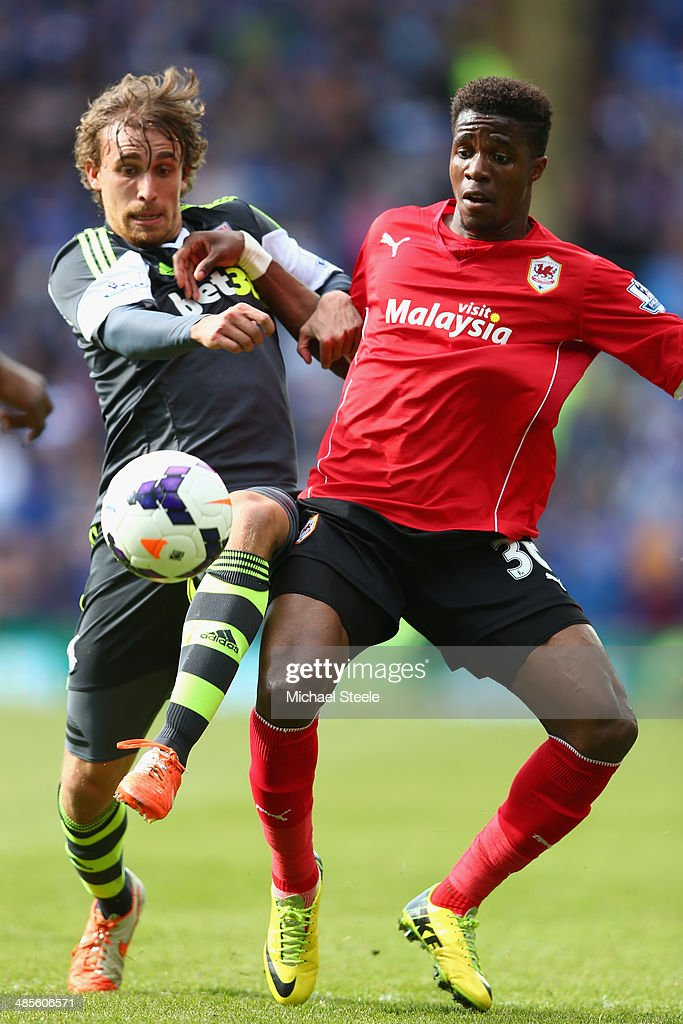 <a gi-track='captionPersonalityLinkClicked' href=/galleries/search?phrase=Wilfried+Zaha&family=editorial&specificpeople=7132531 ng-click='$event.stopPropagation()'>Wilfried Zaha</a> (R) of Cardiff City battles for posession with <a gi-track='captionPersonalityLinkClicked' href=/galleries/search?phrase=Marc+Muniesa&family=editorial&specificpeople=5848057 ng-click='$event.stopPropagation()'>Marc Muniesa</a> (L) of Stoke City during the Barclays Premier League match between Cardiff City and Stoke City at the Cardiff City Stadium on April 19, 2014 in Cardiff, Wales.