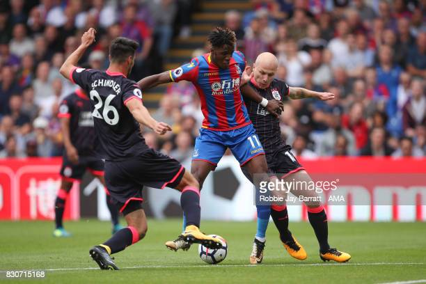 Wilfried Zaha of Crystal Palace and Aaron Mooy of Huddersfield Townduring the Premier League match between Crystal Palace and Huddersfield Town at...