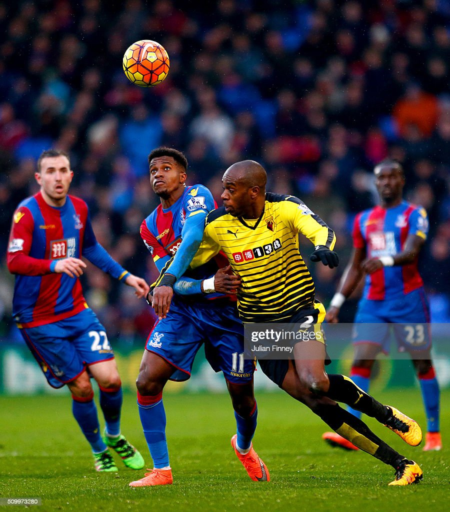 Wilfried Zaha of Crystal Palace and Allan-Romeo Nyom of Watford compete for the ball during the Barclays Premier League match between Crystal Palace and Watford at Selhurst Park on February 13, 2016 in London, England.