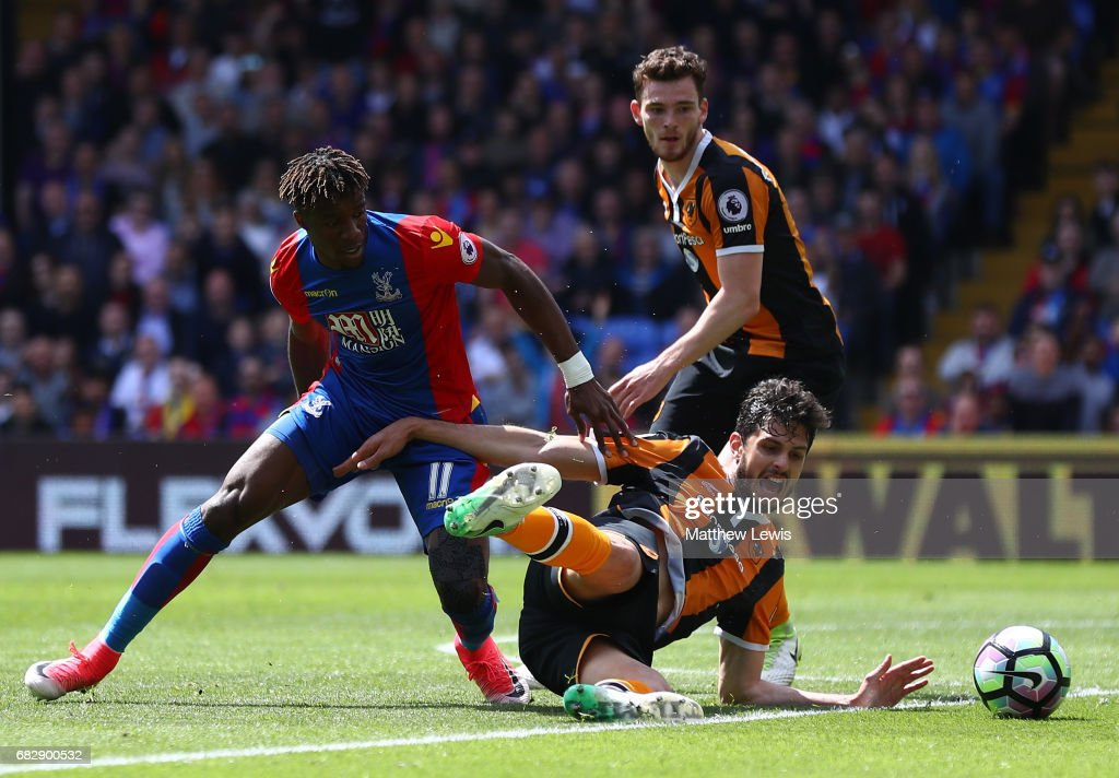 Wilfried Zaha of Crystal Palace and Andrea Ranocchia of Hull City battle for possession during the Premier League match between Crystal Palace and Hull City at Selhurst Park on May 14, 2017 in London, England.