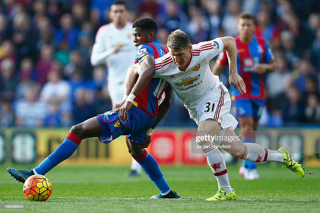 Wilfried Zaha of Crystal Palace and Bastian Schweinsteiger of Manchester United compete for the ball during the Barclays Premier League match between Crystal Palace and Manchester United at Selhurst Park on October 31, 2015 in London, England.