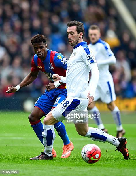 Wilfried Zaha of Crystal Palace and Christian Fuchs of Leicester City compete for the ball during the Barclays Premier League match between Crystal...