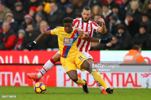Wilfried Zaha of Crystal Palace and Erik Pieters of Stoke City compete for the ball during the Premier League match between Stoke City and Crystal...