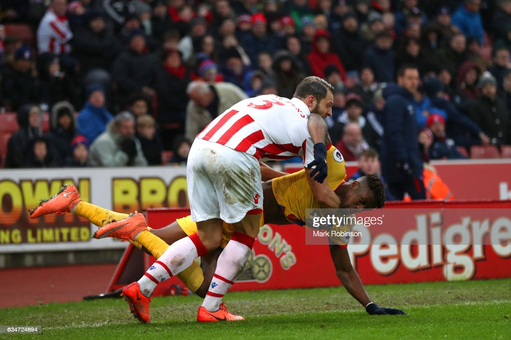 Wilfried Zaha of Crystal Palace and Erik Pieters of Stoke City tussle during the Premier League match between Stoke City and Crystal Palace at Bet365 Stadium on February 11, 2017 in Stoke on Trent, England.