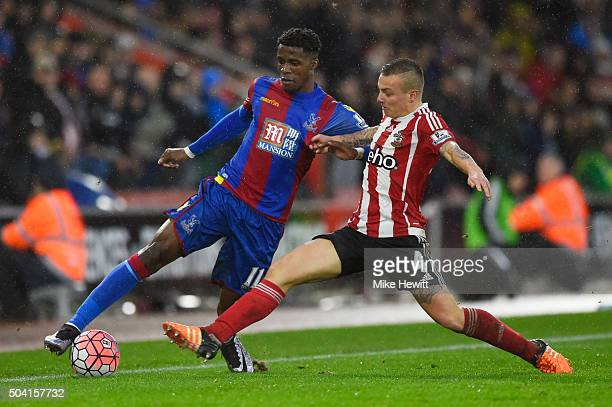 Wilfried Zaha of Crystal Palace and Jordy Clasie of Southampton compete for the ball during the Emirates FA Cup Third Round match between Southampton...