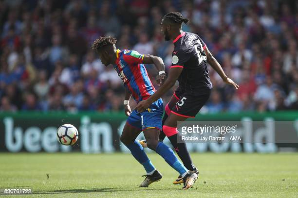Wilfried Zaha of Crystal Palace and Kasey Palmer of Huddersfield Townduring the Premier League match between Crystal Palace and Huddersfield Town at...