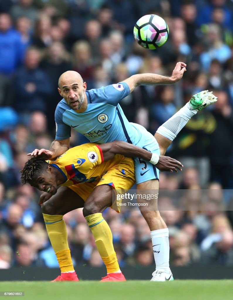 Wilfried Zaha of Crystal Palace and Pablo Zabaleta of Manchester City compete for the ball during the Premier League match between Manchester City and Crystal Palace at the Etihad Stadium on May 6, 2017 in Manchester, England.