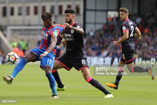 Wilfried Zaha of Crystal Palace and Philip Billing of Huddersfield Townduring the Premier League match between Crystal Palace and Huddersfield Town...