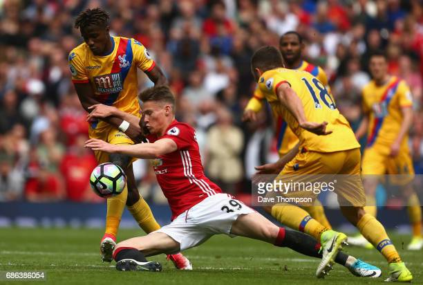 Wilfried Zaha of Crystal Palace and Scott McTominay of Manchester United collide during the Premier League match between Manchester United and...