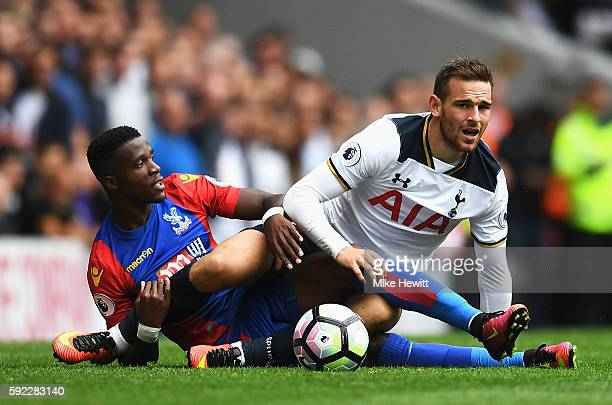 Wilfried Zaha of Crystal Palace and Vincent Janssen of Tottenham Hotspur battle for possession on the floor during the Premier League match between...