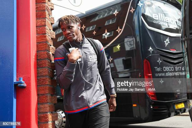 Wilfried Zaha of Crystal Palace arrives prior to the Premier League match between Crystal Palace and Huddersfield Town at Selhurst Park on August 12...