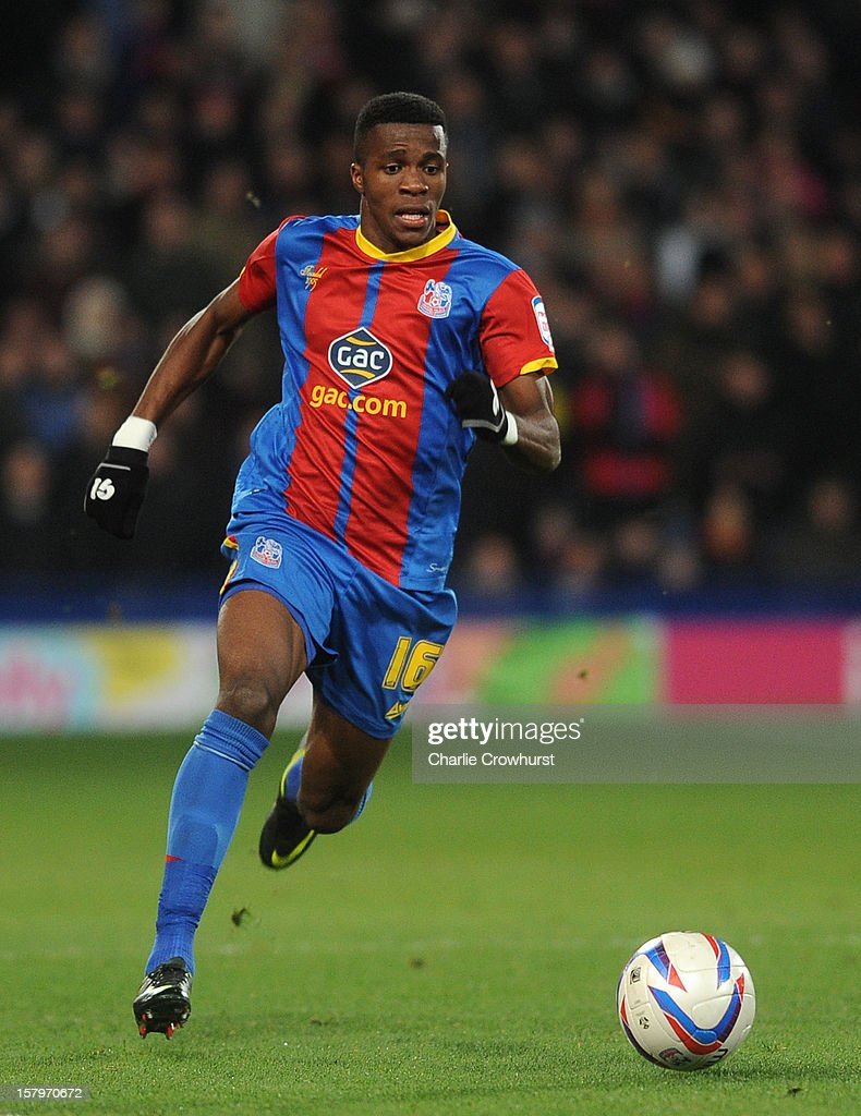 <a gi-track='captionPersonalityLinkClicked' href=/galleries/search?phrase=Wilfried+Zaha&family=editorial&specificpeople=7132531 ng-click='$event.stopPropagation()'>Wilfried Zaha</a> of Crystal Palace attacks during the npower Championship match between Crystal Palace and Blackpool at Selhurt Park on December 08, 2012 in London, England.