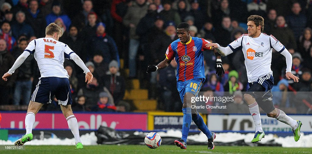 <a gi-track='captionPersonalityLinkClicked' href=/galleries/search?phrase=Wilfried+Zaha&family=editorial&specificpeople=7132531 ng-click='$event.stopPropagation()'>Wilfried Zaha</a> of Crystal Palace attacks during the npower Championship match between Crystal Palace and Bolton at Selhurst Park on January 19, 2013 in London England.