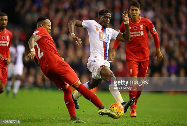 Wilfried Zaha of Crystal Palace battles for the ball with Nathaniel Clyne of Liverpool during the Barclays Premier League match between Liverpool and...
