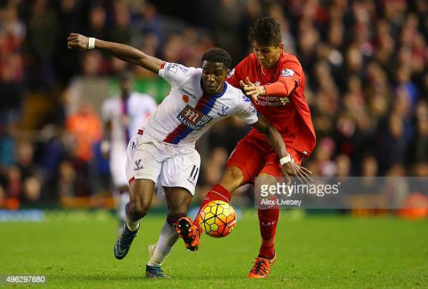 Wilfried Zaha of Crystal Palace battles for the ball with Roberto Firmino of Liverpool during the Barclays Premier League match between Liverpool and...