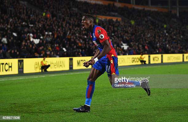 Wilfried Zaha of Crystal Palace celebrates as he scores their second goal during the Premier League match between Hull City and Crystal Palace at...