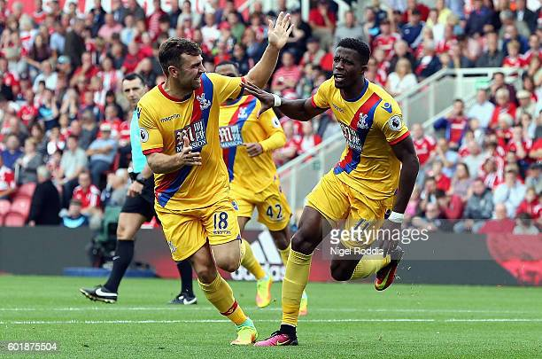 Wilfried Zaha of Crystal Palace celebrates scoring his sides first goal during the Premier League match between Middlesbrough and Crystal Palace at...