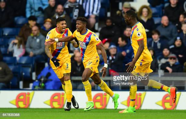 Wilfried Zaha of Crystal Palace celebrates scoring his sides first goal with Patrick van Aanholt of Crystal Palace and Christian Benteke of Crystal...