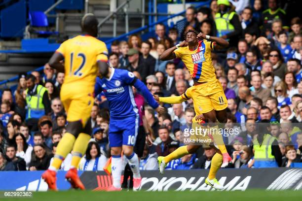 Wilfried Zaha of Crystal Palace celebrates scoring his sides first goal during the Premier League match between Chelsea and Crystal Palace at...