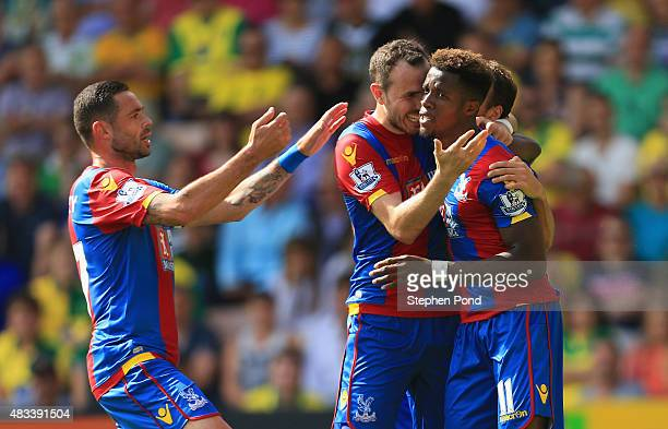 Wilfried Zaha of Crystal Palace celebrates scoring his team's first goal with his team mate during the Barclays Premier League match between Norwich...